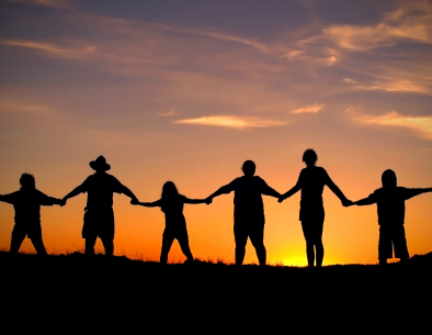 Work to consciously release attachment people-holding-hands-sunset.jpg